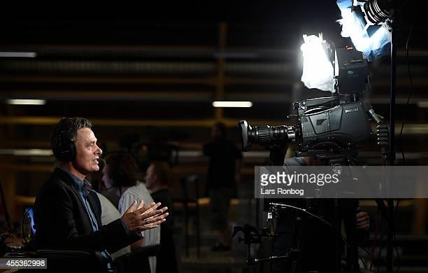 Reporter Thomas Kristensen of TV2 Sporten Danmark reports to live television prior to the Danish Men's Handball Liga match between Aalborg Handbold...