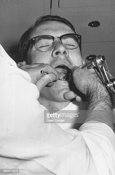 JUL 21 1955 JUL 22 1955 Reporter Tom Hutton ***** undergoes dentist's drilling for the first time
