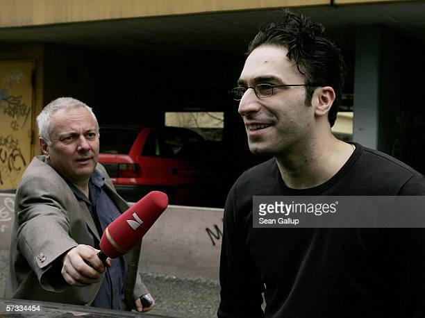 A reporter tries to interview Alpaslan Surucu outside a Berlin courthouse after a court acquitted him and his brother Mutlu Surucu in the killing of...