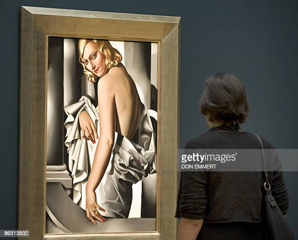 A reporter views Tamara de Lempicka's Portrait de Majorie Ferry during a media preview May 1 2009 at Sotheby's in New York The work from the...