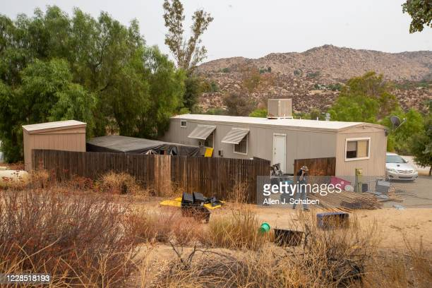 A reporter views the the property where seven people were shot to death over Labor Day weekend at an illegal marijuana grow house in the...