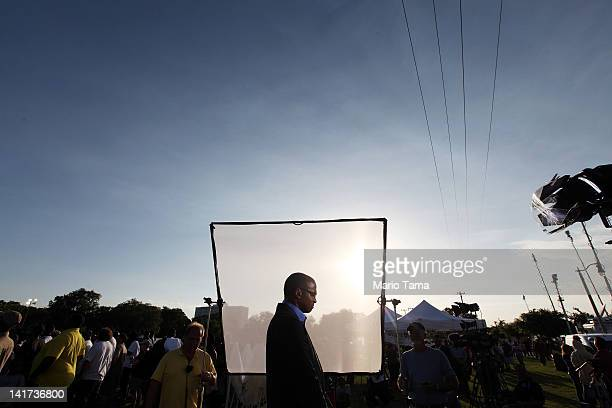 Reporter waits to broadcast at a rally for slain teenager Trayvon Martin on March 22, 2012 in Sanford, Florida. Sanford Police Department Chief Bill...