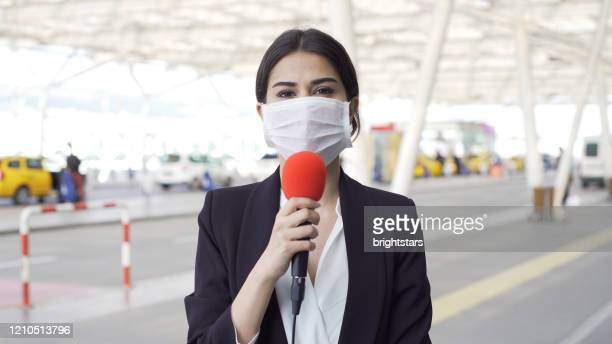 tv reporter wearing a mask - the media stock pictures, royalty-free photos & images