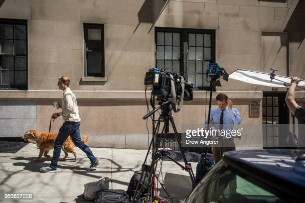 A reporter works outside the office of Dr Harold Bornstein who was previously President Donald Trump's longtime personal physician May 2 2018 in New...
