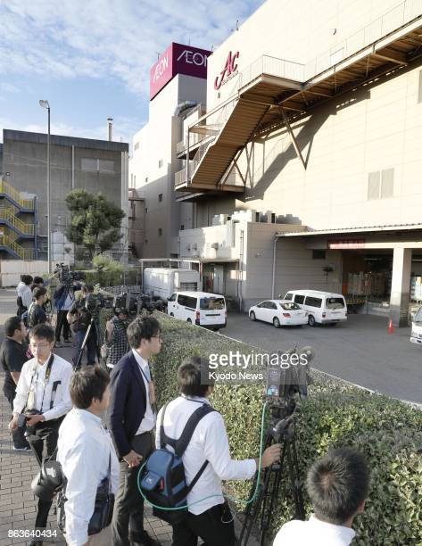 Reporters and camera crew gather in front of an Aeon shopping mall in Onojo Fukuoka Prefecture on Oct 20 where a 44yearold man arrested for alleged...