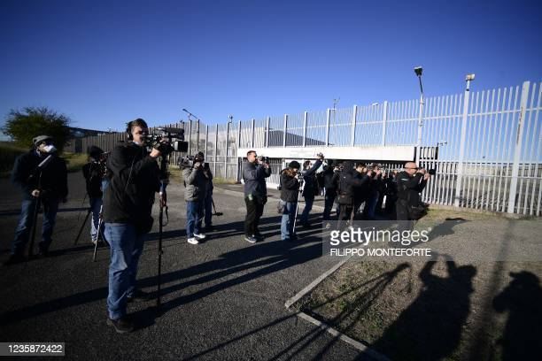 Reporters and journalists gather on October 14, 2021 outside the Rebibbia bunker courtroom in Rome, for the trial in abstentia of four Egyptian...