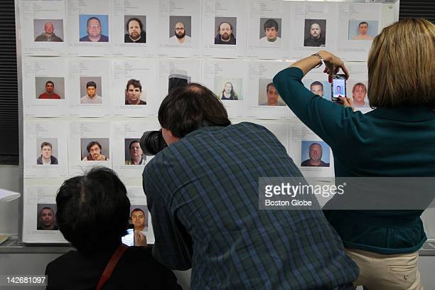 Reporters and photographers document perpetrators before a press conference where state and local officials announce the results of Operation Corral...