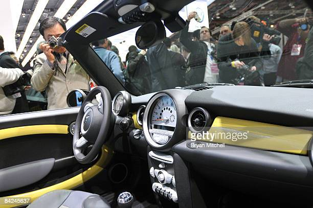 Reporters and photographers look of the interior of the new Mini Convertible during the world premiere of the car to the world automotive media...