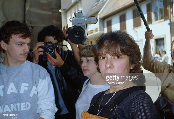 Reporters and photojournalists surround Christine Villemin Gregory Villemin was found dead on October 16 1985 in the Vologne River