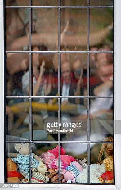 Reporters and television crews are reflected in the playroom window of the McCann family home on September 9 2007 in Rothley England The McCann...