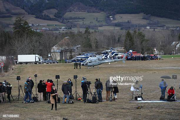 Reporters and television crews gather near where French police and military helicopters have landed on March 25 2015 in Seyne France Germanwings...