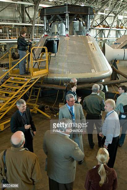 Reporters are given a tour and briefing on the NASA Constellation Program's Orion crew module under development March 12 2008 at the NASA Langley...
