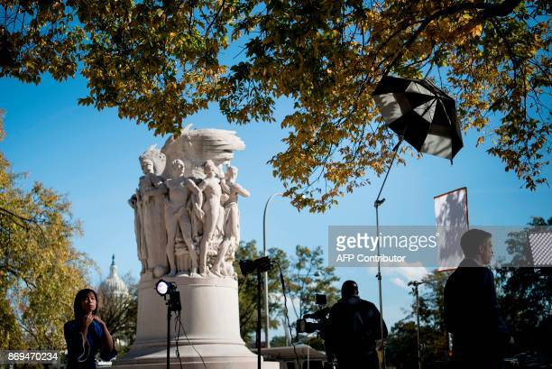 TV reporters are seen as Paul Manafort and Rick Gates former Trump campaign advisors attend a hearing at the US District Court for DC on November 2...