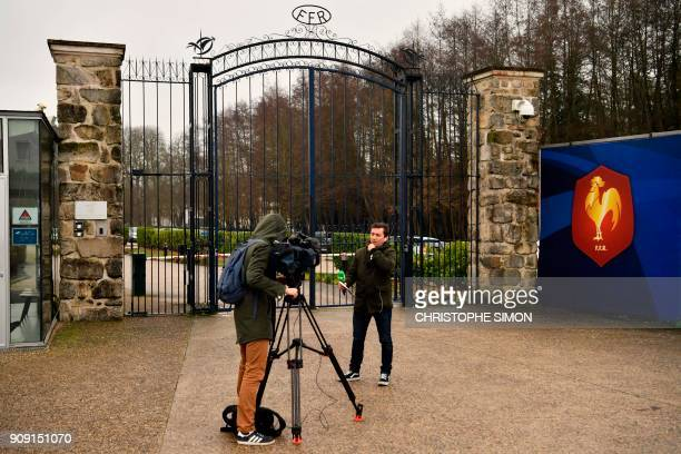 Reporters broadcast from the front entrance of the headquarters of the French Rugby Federation on January 23 2018 in Marcoussis southwest of Paris as...
