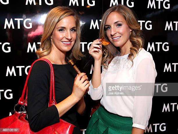 Reporters Brooke Graham and Brittany Graham attend the GRAMMY Gift Lounge during the 56th Grammy Awards at Staples Center on January 25 2014 in Los...