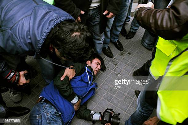 Reporters crowd around a man identified as Farahim Ibrahimoglu a journalist of Yeni Musavat newspaper who was reportedly beaten by police officers...