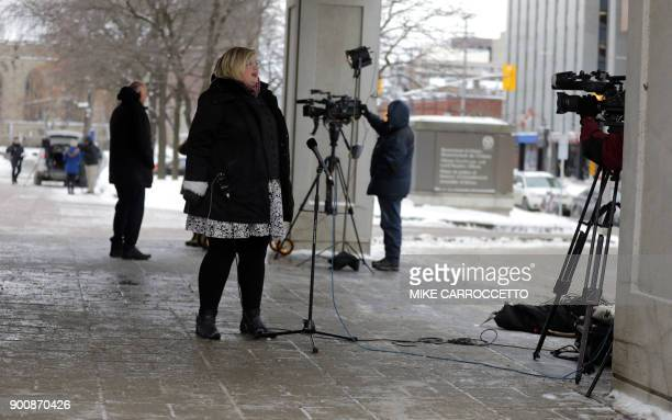 Reporters do their standups outside the courthouse in Ottawa Canada January 3 2018 where former Taliban hostage Joshua Boyle briefly appeared via...