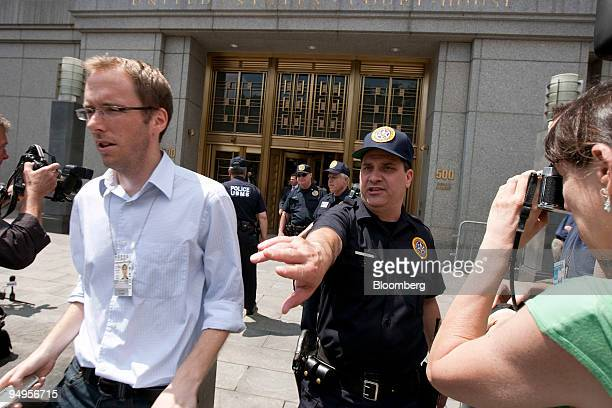 Reporters file out of federal court after the sentencing of Bernard Madoff founder of Bernard L Madoff Investment Securities LLC in New York US on...