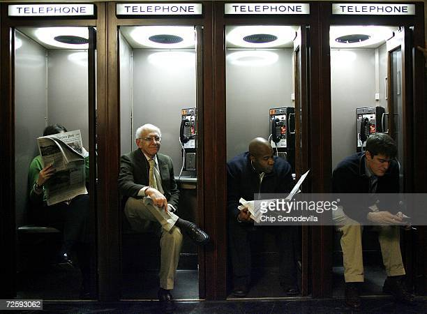 Reporters find seats inside wooden telephone booths while waiting for the results of the House Republican Conference leadership elections in the...