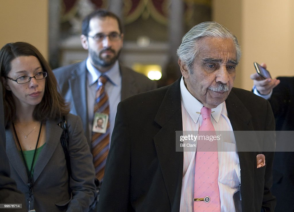 Reporters follow Rep. Charlie Rangel, D-N.Y., through Statuary Hall as he leaves Speaker Pelosi's office on Tuesday, Oct. 27, 2009.