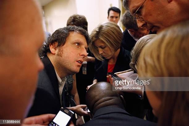 Reporters gather around a digital audio recorder to hear what Central Intelligence Agency Director Leon Panetta told a reporter after briefing...
