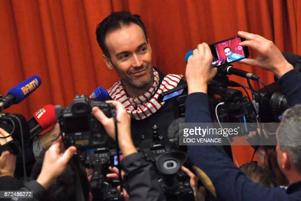 Reporters gather around former director of the French Alliance in Irkutsk Yoann Barbereau during a press conference on November 10 2017 in Nantes...