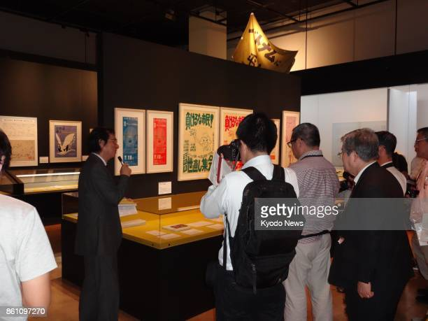 Reporters gather for a press preview of an exhibition '1968 A Time filled with Countless Questions' at the National Museum of Japanese History in the...