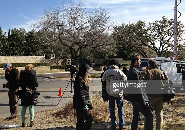 Reporters gather in front of cyclist Lance Armstrong's house in Austin Texas January 14 2013 Armstrong is scheduled to appear on US talk show host...