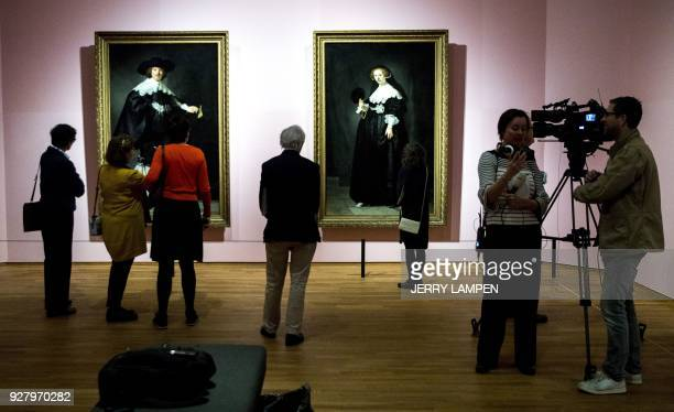 Reporters gather in front of Rembrandt's 1634 paintings 'Portrait of Maerten Soolmans' and 'Portrait of Oopjen Coppit' at the exhibition 'High...