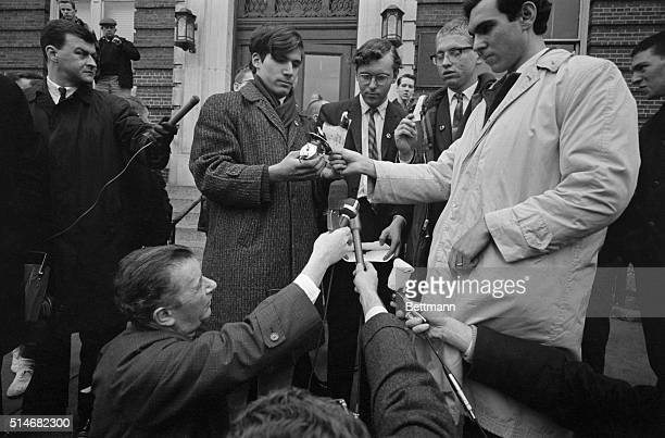 Reporters gather near CNA pacifists David A Reed of Voluntown Connecticut David P O'Brien of Boston David Benson of Morgantown Virginia and John A...