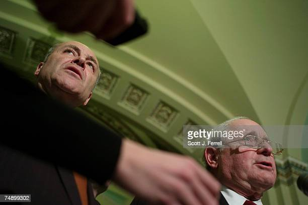 Reporters holding recorders frame Senate DSCC Chairman Charles E Schumer DNY and Senate Armed Services Chairman Carl Levin DMich during a news...