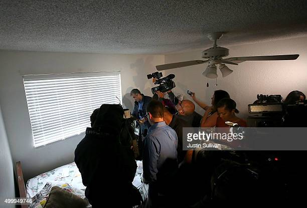 Reporters inspect papers found inside the home of shooting suspect Syed Farook on December 4, 2015 in Redlands, California. The San Bernardino...