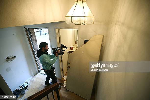 Reporters inspect the home of Syed Farook on December 4 2015 in Redlands California The San Bernardino community is mourning as police continue to...