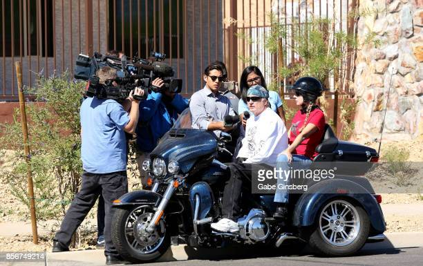 Reporters interview a resident of the Sun City Mesquite community where suspected Las Vegas gunman Stephen Paddock lived in Mesquite Nevada on...