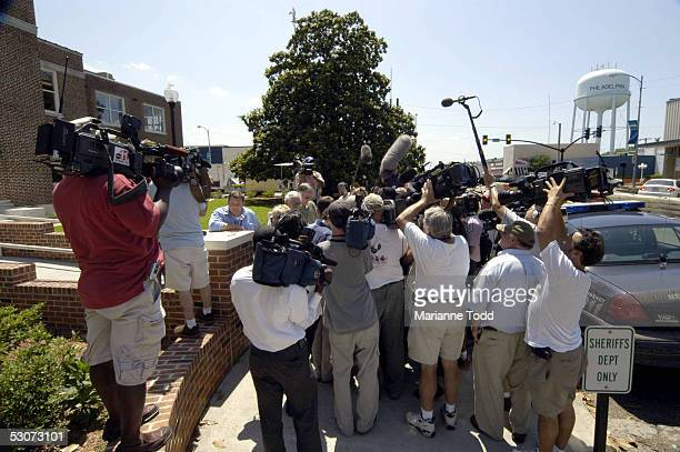 Reporters interview defense attorney James McIntyre outside the Neshoba County Courthouse after opening arguments on June 15 2005 in Philadelphia...