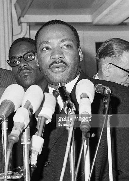Reporters interview Reverend Martin Luther King Jr after his meeting with President Johnson at the White House where they discussed civil rights...