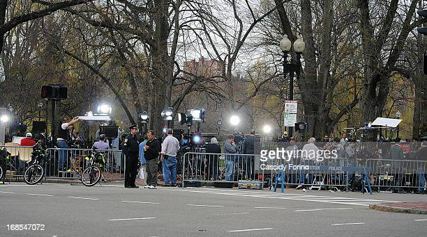 Reporters line the streets of Boston the day after the Boston Marathon bombing.
