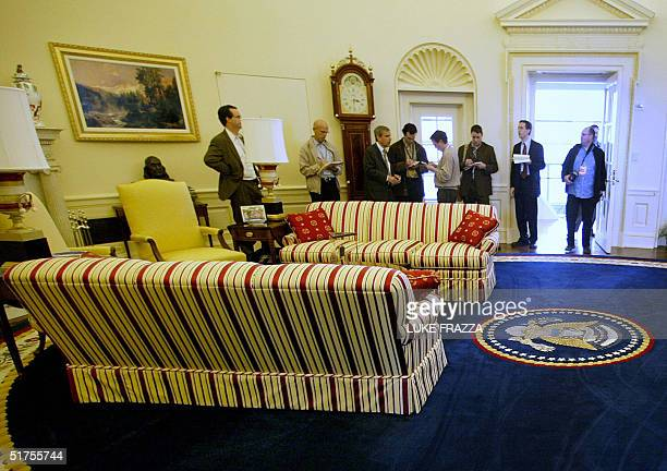 Reporters listen to Bruce Lindsay , former Senior Advisor to former President Bill Clinton, in a recreation of the Clinton's White House Oval Office...
