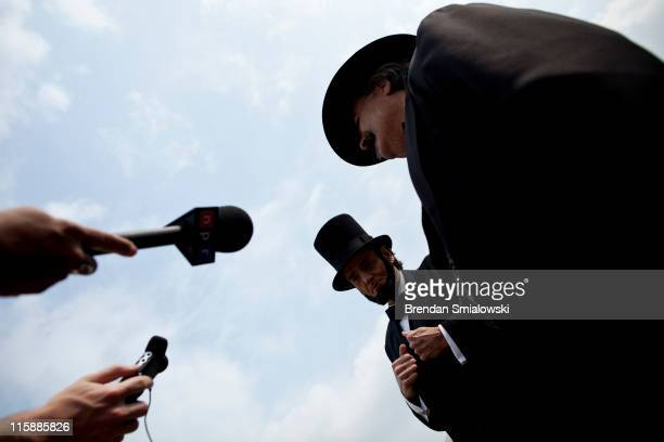 Reporters listen to Charles Brady an Abraham Lincoln portrayer and Kevin Knapp a Thaddeus Lowe portrayer talk during a balloon demonstration on the...
