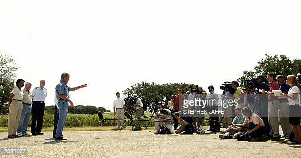 Reporters listen to US President George W Bush at his Crawford Texas ranch 08 August 2003 The US has been able to make a great deal of progress in...