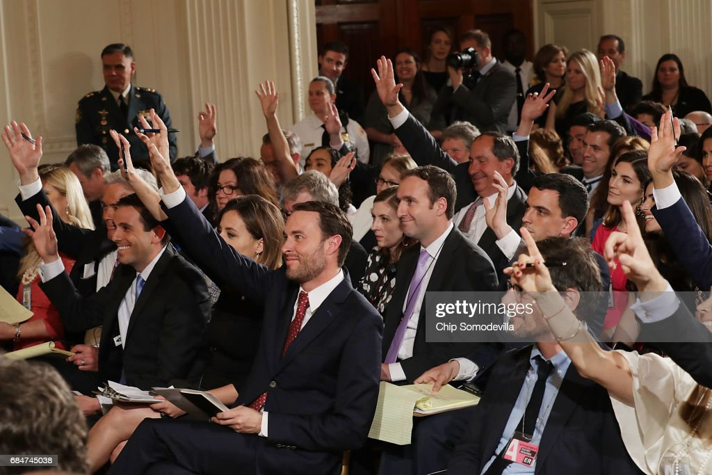 Reporters raise their hands to ask questions during a news conference with Colombian President Juan Manuel Santos and U.S. President Donald Trump in the East Room of the White House May 18, 2017 in Washington, DC. The Trump administration has said it wants to slash foreign aide and Santos will most likely seek a renewal of $450 million dollars from the U.S. that supports the peace accord between the Columbian government at the Revolutionary Armed Forces (FARC).