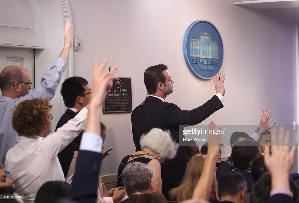 Reporters raise their hands to ask White House Deputy Press Secretary Sarah Huckabee Sanders a question during the press briefing on July 11, 2017 in Washington, DC. Sanders fielded questions regarding President Donald Trump's eldest son Donald Trump Jr. and his meeting with a Russian Lawyer.