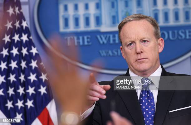 Reporters raise their hands with questions for White House Press Secretary Sean Spicer speaks during the daily briefing in the Brady Briefing Room of...