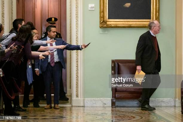 Reporters reach out with their cell phones and audio recorders trying to get a statement from Sen Lamar Alexander as he passes by during a recess in...