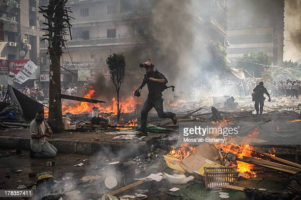 CONTENT] Reporters run for cover during clashes between Muslim Brotherhood supporters of Egypt's ousted president Mohamed Morsi and police in Cairo...