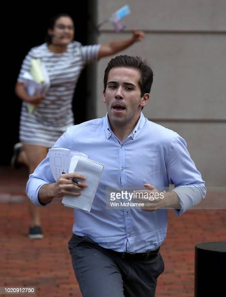 Reporters run from the Albert V Bryan United States Courthouse with news of the verdict in the case of former Trump campaign chairman Paul Manafort...