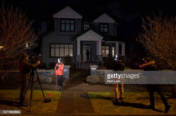 Reporters set up outside the home of Huawei Technologies CFO Meng Wanzhou while a security guard stands after Meng was granted bail on December 11...