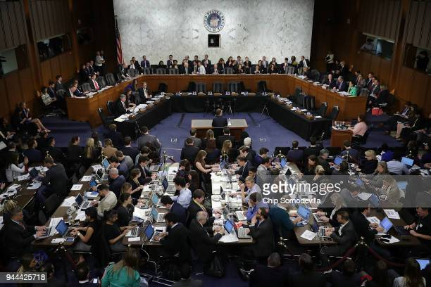 Reporters sit shouldertoshoulder behind Facebook cofounder Chairman and CEO Mark Zuckerberg as he testifies before a combined Senate Judiciary and...