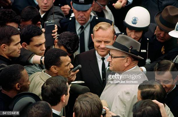 Reporters surround civil rights leader Reverend C.T. Vivian and Director of Public Safety Wilson Baker before march from Selma.