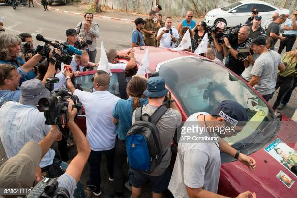 Reporters surround the car of Israeli soldier Elor Azaria who was convicted of manslaughter and sentenced to 18 months imprisonment for killing a...